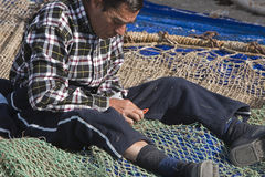 Sailor fixed their fishing nets in the port of Estepona, Royalty Free Stock Photography