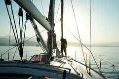 Sailor on the front deck at the nose of the boat. Royalty Free Stock Photography