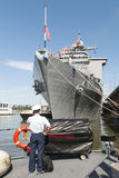Sailor in front of the USS Oak Hill in New York City. For Fleet Week 2014 Royalty Free Stock Photography