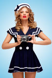 Sailor girl with camera. Stock Photos