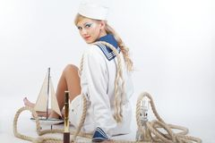 Sailor Girl with telescope and rope Stock Photo