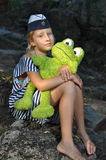 Sailor girl with a toy frog Royalty Free Stock Photography