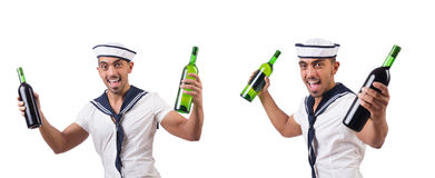 The sailor isolated with wine bottle Royalty Free Stock Photo
