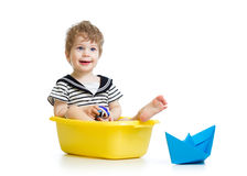 Sailor kid boy sitting inside bathtub Stock Photo