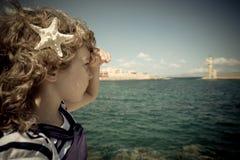 Sailor kid looking through the binoculars Royalty Free Stock Image