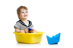 Sailor kid sitting inside washbowl Royalty Free Stock Photo
