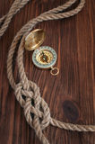 Sailor knot and brass compass Royalty Free Stock Images