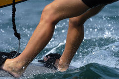 Sailor legs. A sailor's legs on a sailboard in the surf Royalty Free Stock Images