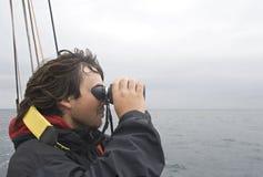 Sailor looking in binoculars Stock Images