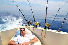 Sailor man fishing resting in boat summer vacation. Blue sea Royalty Free Stock Photos