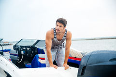 Sailor man in his motor boat Royalty Free Stock Photography
