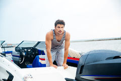 Sailor man in his motor boat Royalty Free Stock Images