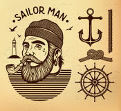 Sailor man with pipe. Portrait of bearded sailor with tobacco pipe. Hipster sailor man. Bearded boat captain smoking pipe Stock Images