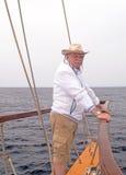 Sailor man sailing boat ocean water Mediterranean sea Stock Image