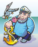 Sailor. A man standing on the bank of a sailor smoking a pipe looking at the seagull flies Royalty Free Stock Images