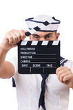 Sailor with movie board isolated on white Stock Image