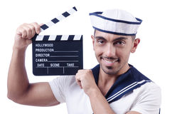 Sailor with movie clapper Royalty Free Stock Images