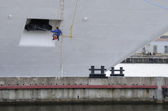 Sailor paints the ship. Current face lifting of the ship Stock Image