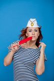 Sailor with a pen. Sailor girl in a striped vest with a red pen Stock Images