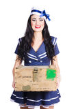 Sailor pin up holding nautical supplies Stock Photography
