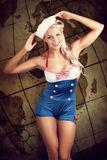 Sailor Pinup Girl On Vintage Travel Map Background Royalty Free Stock Images