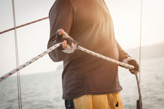 Sailor pulling rope Stock Photography
