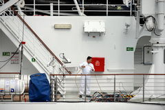 The sailor puts things in order on the ship in the port of Punta Arenas. Royalty Free Stock Images