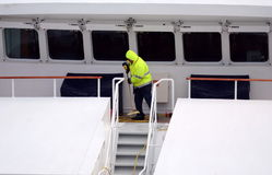 The sailor puts things in order on the ship in the port of Punta Arenas. Stock Photography