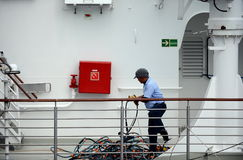The sailor puts things in order on the ship in the port of Punta Arenas. Royalty Free Stock Photos