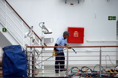 The sailor puts things in order on the ship in the port of Punta Arenas. Royalty Free Stock Photography