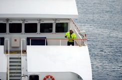 The sailor puts things in order on the ship in the port of Punta Arenas. Stock Images
