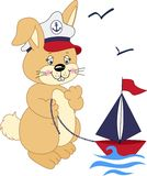 Sailor rabbit playing with a boat Royalty Free Stock Photos