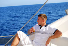 Sailor relaxing on boat drinking cold coffee Stock Photography