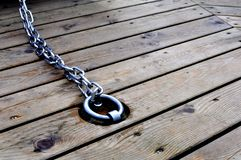 Sailor rope and knot on a wooden pier at the seaside stock photography