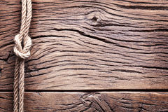 Sailor's knot over old wood. Stock Photos