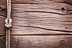 Sailor's knot over old wood. Royalty Free Stock Photo