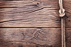 Sailor's knot over old wood. Royalty Free Stock Photography