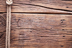 Sailor's knot over old wood. Stock Photo