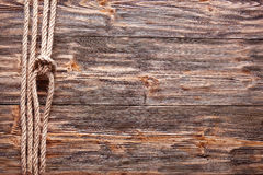 Sailor's knot over old wooden desk. Stock Photography