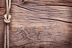 Sailor's knot over wood. Royalty Free Stock Image