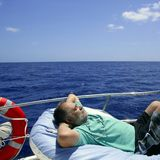 Sailor senior man having a rest on summer boat Stock Image