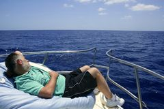 Sailor senior man having a rest on summer boat Stock Photography