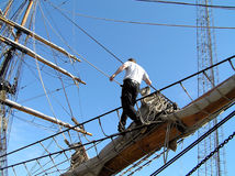Sailor showing mastery. Climbing the MAST Stock Photography