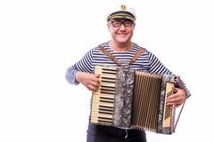 Sailor showman singer with musical instruments drum and accordion. On white back royalty free stock images