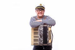 Sailor showman singer with musical instruments drum and accordion. On white back Royalty Free Stock Image