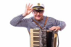 Sailor showman singer with musical instruments drum and accordion. On white back Royalty Free Stock Photos