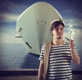 Sailor smokes in front of ship Royalty Free Stock Image
