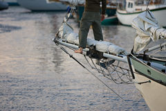 Sailor stands on bowsprit Stock Photography
