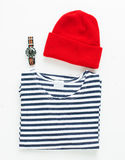 Sailor striped shirt and red wool cap with diving watch Stock Photo