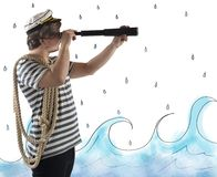 Sailor with the telescope. Sailor looks at the sea with the telescope royalty free stock photos